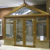 Gable front conservatory in golden oak effect